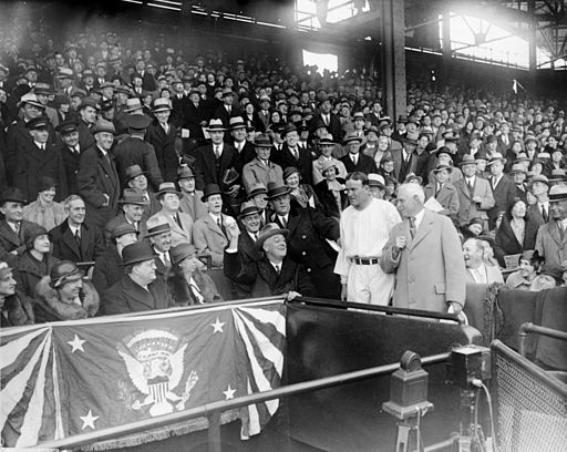 Franklin Roosevelt throwing out the opening pitch at Griffith Stadium, 1933. Image Courtesy Wikimedia Commons via Harris and Ewing.