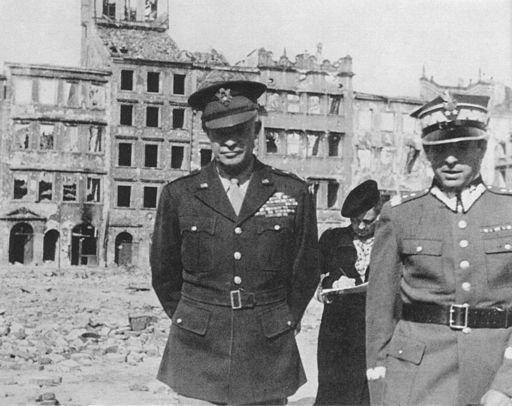General Dwight Eisenhower in ruins at Warsaw, 1944. By Central Photographic Agency on Wikimedia Commons, Public Domain.