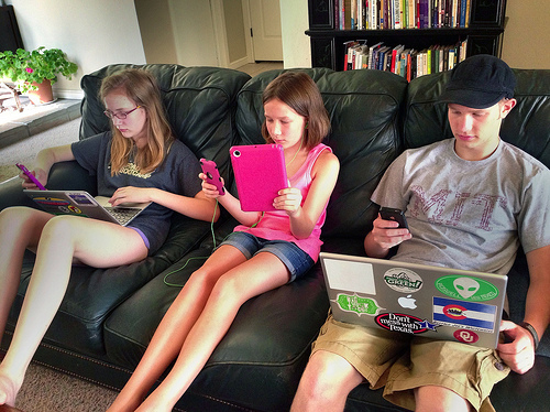 Kids playing mobile games.